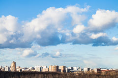 Clouds in blue spring sky over city Stock Photography