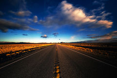 Clouds Blur Over A Desert Highway Royalty Free Stock Photo