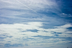 Clouds. Blus sky, clouds and a airplane Stock Photos