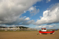Clouds and Boats. Instow sands looking across the water to the seaside village of Appledore. North Devon. England Royalty Free Stock Photos