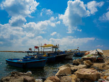 Clouds and boats Stock Image