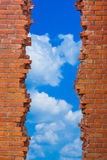 Clouds in the breach walls Stock Photo