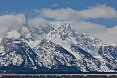 The clouds break. The Grand Tetons in afternoon sun Stock Photography