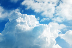 Clouds and a bright sun close up Stock Image