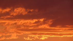 Clouds burns on the sky. Sunset royalty free stock photos