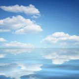 Clouds and calm water. Clouds and reflection in calm blue water Royalty Free Stock Photography