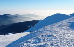 Clouds in the Carpathian Mountains and ski slopes at the Sinaia Royalty Free Stock Photography