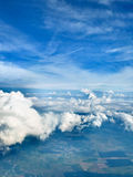 Clouds with a chance of land. Sky clouds airplane view  blue skyscape horizon Stock Photo