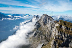 Clouds at the Churfirsten mountains Royalty Free Stock Images