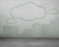Clouds and city buildings of green doodles on concrete wall. Clouds and city buildings of green color doodles hand drawn on concrete wall stock photo