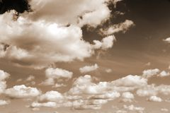 Clouds in the clear sky with sepia effect Royalty Free Stock Images