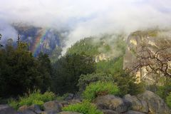 Rainbow and Evening Sun over Merced River Valley at Elephant Rock, Yosemite National Park, California stock photo