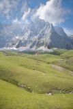 Clouds cliff and cottage in Cantabrian mountains Stock Photos