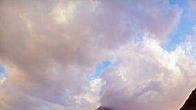 Clouds cling to the mountain. Pamir, Tajikistan. Royalty Free Stock Photo