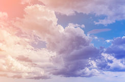 Clouds. Color toned image. White clouds with blue sky background. Color toned image Stock Photos