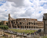 Clouds by the Colosseum. The Colosseum in Rome on a cloudy morning Royalty Free Stock Images