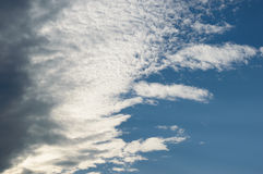 Clouds comming from the left. Covering half of the frame in a dark blue sky Royalty Free Stock Images