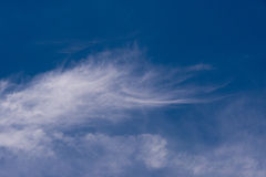 Clouds in Cornwall. Blue sky and wispy clouds in Cornwall, United Kindom, UK Royalty Free Stock Photo