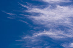 Clouds in Cornwall. Blue sky and wispy clouds in Cornwall, United Kindom, UK Stock Image