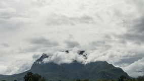 Clouds cover the mountain stock footage
