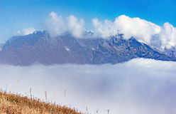 Clouds cover mountain. Stock Photo