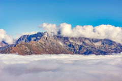 Clouds cover the mountain tops. Stock Image