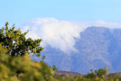 Clouds covering half of the mountains Royalty Free Stock Images
