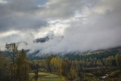 Clouds covering hills in British Columbia stock image