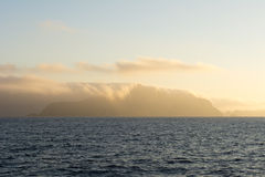 Clouds covering island Royalty Free Stock Photography