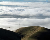 Clouds Covering a Mountain Valley with Rolling Hills Royalty Free Stock Images