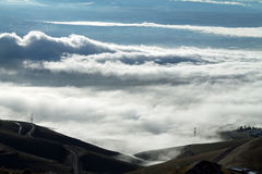 Clouds Covering a Mountain Valley with Rolling Hills Royalty Free Stock Image