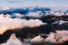Clouds covering mountains Stock Photo