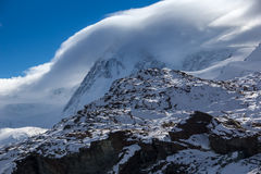 Clouds covering Swiss Alps near Mount Matterhorn, Canton of Valais Royalty Free Stock Image