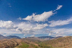 Clouds in Crimea. Clouds over the vineyard in Crimea, beautiful mountain landscape Royalty Free Stock Image