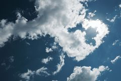 Cumulus clouds are white on a dark background stock image