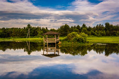 Clouds and damaged gazebo reflecting in a pond, in the Potomac H Royalty Free Stock Photos