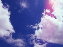 Clouds in the dark blue sky stock photos