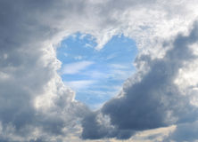 Clouds darkened the skies with blue skies-heart Stock Photos