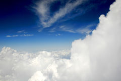 Clouds and Deep Blue Sky. Spectaclular Fluffy White Clouds from Outside of Plane Stock Image
