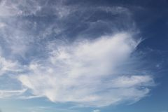 Clouds in deep blue sky stock photo