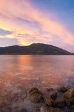 clouds den undervattens- solnedgången för korallredrocks Royaltyfria Bilder
