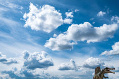 Clouds and dinosaur Royalty Free Stock Photo