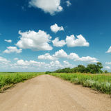 Clouds and dirty road Stock Photography