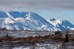 Clouds Disappear over Snowy Mountains Stock Photos
