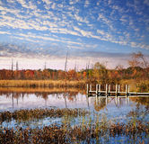 Clouds, Dock And Lake In Autumn Stock Photography