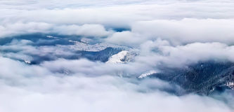 Through the clouds. Down through the clouds  and fog Stock Photos
