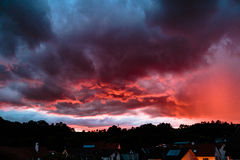 Clouds. Dramatic red sunrise and dark clouds Royalty Free Stock Images