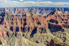 White Clouds Drift Over the Grand Canyon of Arizona royalty free stock photo