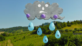 Clouds and drops of water are falling down Royalty Free Stock Photography