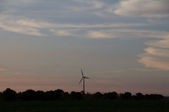 Clouds at Dusk with a Windmill Stock Photography